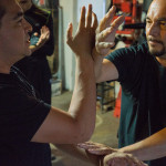 2015-10-10 - Hayward, CA - Instructor Tommy Robles going over technique with students.